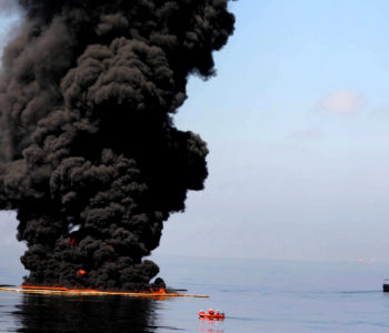"""100506-N-6070S-346 Gulf of Mexico (May 6, 2010) -- Dark clouds of smoke and fire emerge as oil burns during a controlled fire in the Gulf of Mexico. The U.S. Coast Guard working in partnership with BP PLC, local residents, and other federal agencies conducted the """"in situ burn"""" to aid in preventing the spread of oil following the April 20 explosion on Mobile Offshore Drilling Unit Deepwater Horizon. (U.S. Navy photo by Mass Communication Specialist 2nd Class Justin Stumberg/Released)"""