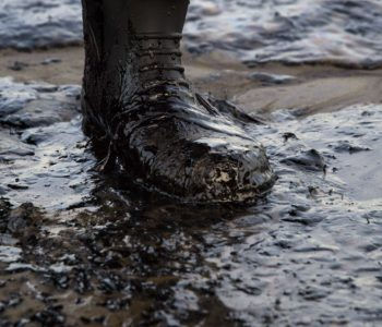 Oil covers a local resident's boot at Refugio State Beach in Goleta, California, May 19, 2015.  An oil pipeline ruptured dumping oil into the Pacific Ocean near Santa Barbara, California, the US Coast Guard said. The spill was estimated at 21,000 gallons (80,000 liters) of oil, local media reported. AFP PHOTO/ ROBYN BECKROBYN BECK/AFP/Getty Images