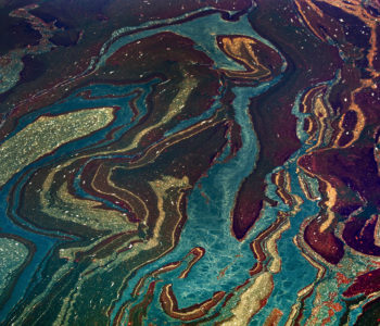 Oil floats in the Gulf of Mexico near Orange Beach, Alabama, U.S., on Friday, June 18, 2010. The BP Plc oil spill, which began when the leased Transocean Deepwater Horizon oil rig exploded on April 20, is gushing as much as 60,000 barrels of oil a day into the Gulf of Mexico, the government said. Photographer: Kari Goodnough/Bloomberg via Getty Images